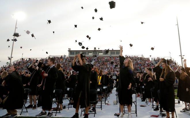 De Pere High School seniors participate in their graduation ceremony on June 7.
