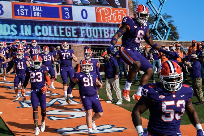 Clemson linebacker Mike Jones Jr. (6) jumps as he runs down the hill before the Tigers' November 2020 game against Pittsburgh at Memorial Stadium. [Ken Ruinard USA TODAY Sports]