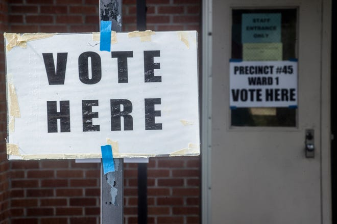 Voting signage is in place for voters during Jackson's general election at precinct 45, located at McLeod Elementary School, in Jackson, Miss., Tuesday, June 8, 2021.