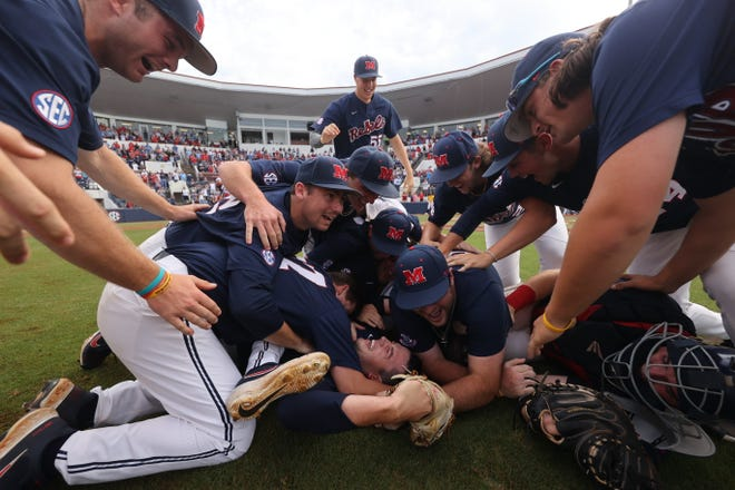 Ole Miss players leap onto a dogpile with teammates after the Rebels won their own Oxford Regional earlier this month. Dogpiles are becoming more common at the regional and super regional level in college baseball (but not at Texas).