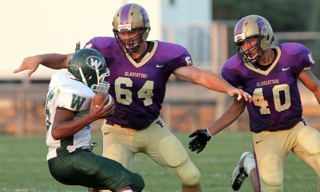 Adam Coon (64) was an all-state football player for Fowlerville as a senior in 2012.
