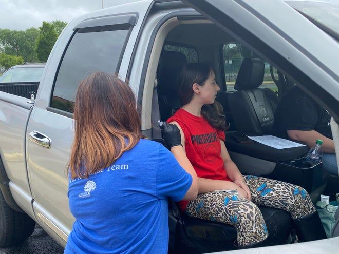 Nursing director Sarah Nicewaner administers a Pfizer shot to Erin Bruen, 14, of Marion. Bruen was a part of a vaccination clinic at Taft Elementary School Monday, June 7, 2021.