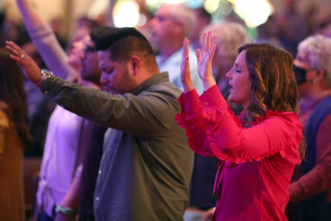 Next Generation Ministry Director Julia Jeffress Sadler participates in the contemporary service at First Baptist Dallas on Sunday, March 21, 2021, in Dallas. (AP Photo/Richard W. Rodriguez)