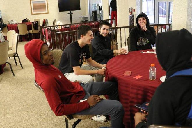 (Left to right), Kalen Williams, James Kohout, Cesar Lujan-Flores and Devin Bermudez share a laugh during the New Mexico State men's basketball team's time at Arizona Grand Resort & Spa in Phoenix, Arizona.