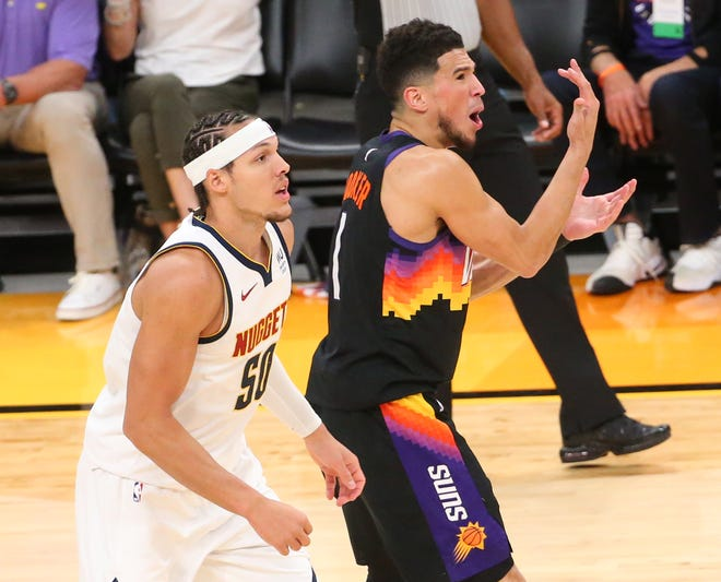 Phoenix Suns guard Devin Booker (1) calls for a foul against Denver Nuggets forward Aaron Gordon (50) during the second quarter of the NBA second round playoff series in Phoenix. June 7, 2021.