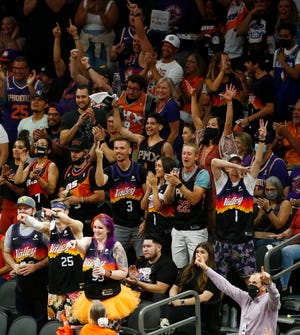 June 7, 2021; Phoenix, Arizona, USA; Suns fans react to a basket tying the game during the first quarter at the Phoenix Suns Arena. Patrick Breen-Arizona Republic