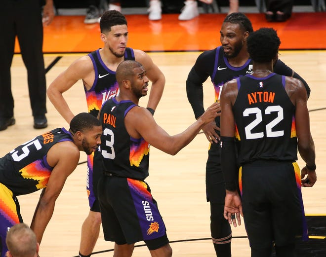 Phoenix Suns guard Chris Paul (3) talks to his teammates during the first quarter against the Denver Nuggets in the NBA second round playoff series in Phoenix. June 7, 2021.