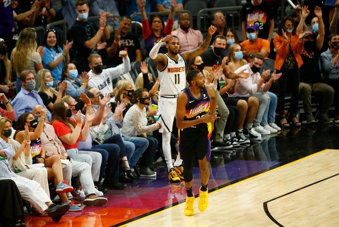 June 7, 2021; Phoenix, Arizona, USA; Suns' Mikal Bridges (25) celebrates after a three pointer against Nuggets' Monte Morris (11) during the second quarter at the Phoenix Suns Arena. Patrick Breen-Arizona Republic