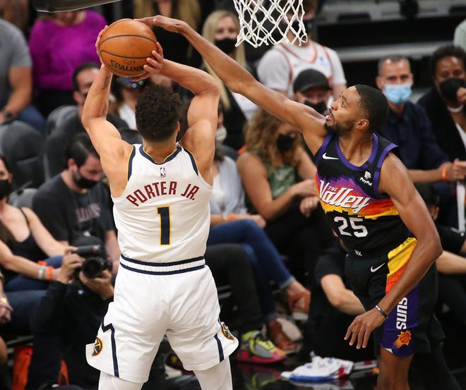 Phoenix Suns forward Mikal Bridges (25) blocks a shot by Denver Nuggets forward Michael Porter Jr. (1) during the first quarter of the NBA second round playoff series in Phoenix. June 7, 2021.