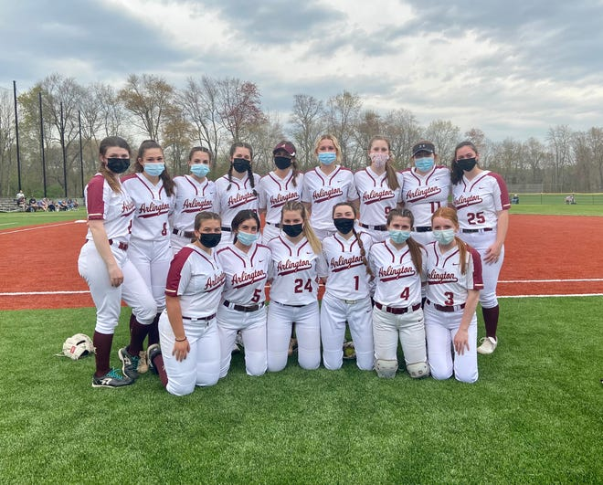 The Arlington softball team poses as it debuts its new field before the April 28 season opener.