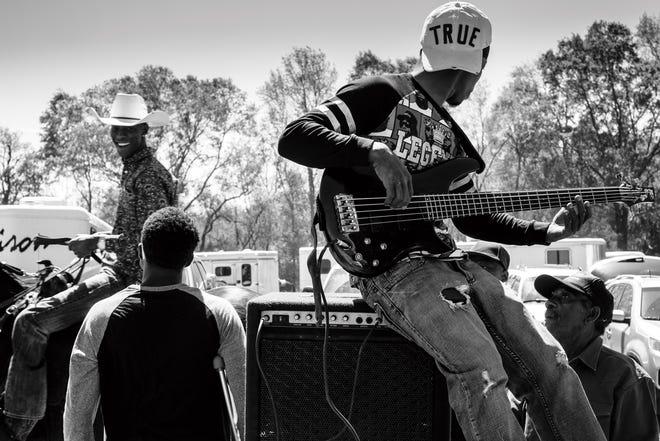 Musician on Trailer, (Opelousas) 2016 by photographer Jeremiah Ariaz