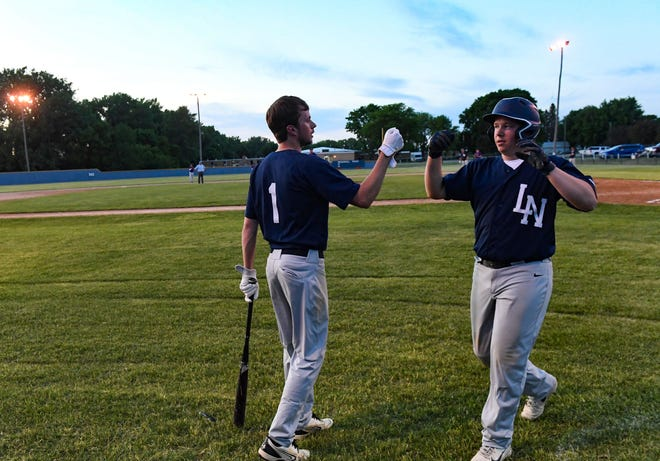 Lake Norden players fist bump after an inning on Wednesday, June 2, 2021 at the Lake Norden baseball field.