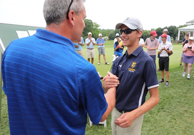 Section 1 golf chair John Bauerlein, left, presents Lourdes' Darren Horton with the champion plaque after winning the Section 1 boys golf championship at Wykagyl Country Club in New Rochelle on Tuesday.