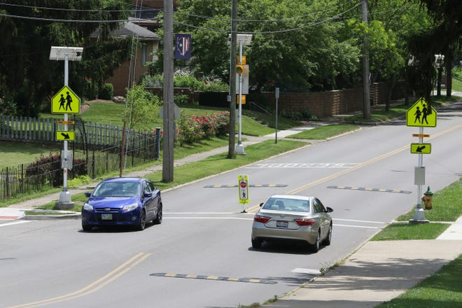 Traffic passes through the intersection of Locust and Blue avenues in Zanesville, where a crosswalk with speed humps has been installed to protect children crossing to Zanesville Middle School.