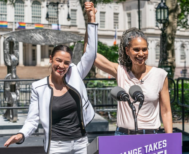 Mayoral candidate Maya Wiley, right, receives Rep. Alexandria Ocasio-Cortez's endorsement for mayor at City Hall Park in New York on June 5. She also endorsed Brad Lander for Manhattan Borough president and Jumaane Williams for city public advocate.