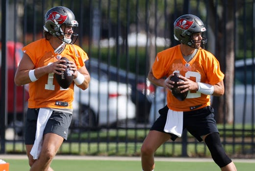 Tampa Bay Buccaneers quarterbacks Tom Brady (right) and Blaine Gabbert work out during minicamp at AdventHealth Training Center on June 8.
