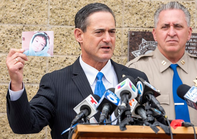 Orange County District Attorney Todd Spitzer holds up a photo of Aiden Leos during a news conference outside the CHP office in Santa Ana, Calif. on Monday, June 7, 2021 to update on the investigation into the shooting death of 6-year-old Aiden Leos.