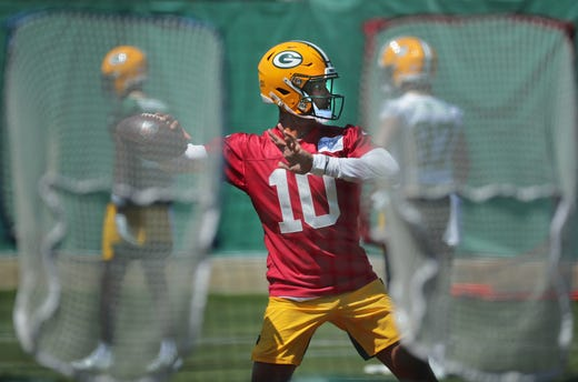 Green Bay Packers quarterback Jordan Love works out during mandatory minicamp in Green Bay, Wis.