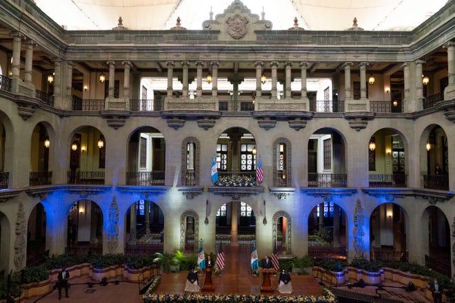 Vice President Kamala Harris, left, and Guatemalan President Alejandro Giammattei, attend a news conference, Monday, June 7, 2021, at the National Palace in Guatemala City.