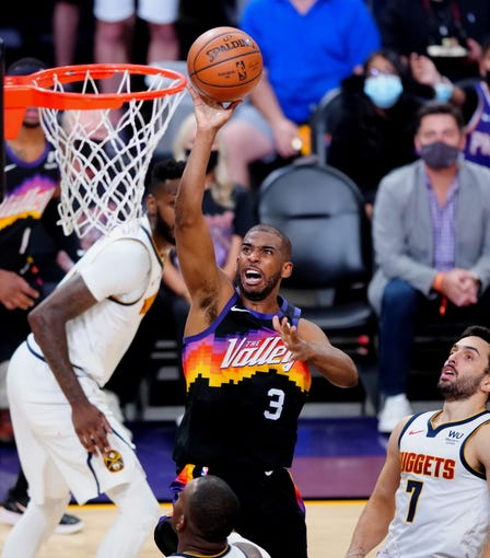 The Phoenix Suns' Chris Paul drives to the basket against the Denver Nuggets in the second half of Game 1 at Phoenix Suns Arena on June 7. The Suns won the game, 122-105.