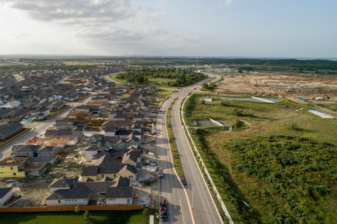New homes are under construction on Apogee Road in Southeast Austin, on the edge of the city limits. Austin officials say homes under construction and adopting the WUI Code standard will be the future barrier to help protect the city from wildfires.