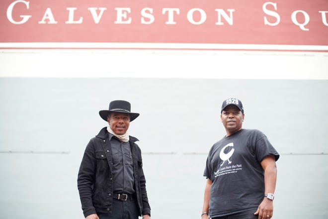 Mural artist Reginald Adams, left, and Sam Collins, a local historian, stand at the site where the mural honoring Juneteenth will be displayed in Galveston's Strand Historic District.