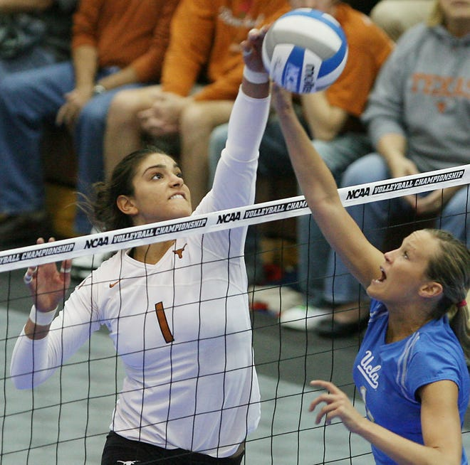 Juliann Faucette, left, spikes the ball for Texas past UCLA's Nellie Spicer during the 2008 NCAA volleyball tournament. Juliann (Faucette) Johnson has taken over the St. Stephen's volleyball program after ending her professional playing career.