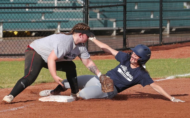 Kennedy Rorar of Tallmadge beats the tag from Madi Harshbarger of Barberton during the 2020 Softball All-Star game at Firestone Stadium on Tuesday night. [Mike Cardew/Beacon Journal]