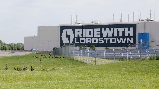 Canada geese wander beyond the fence Wednesday at Lordstown Motors in Lordstown, Ohio. The startup electric vehicle company that opened on the site of a former General Motors plant revealed Tuesday that it is struggling to meet its production launch goals.