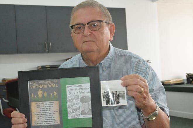 Vietnam veteran Phil Stanley, of Hampton, displays photos of his late friend, Jimmy Morrison.
