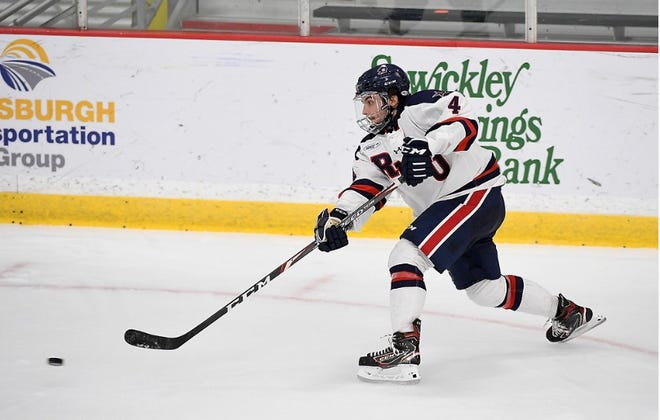 Tyler Love takes a shot at the net in his first season on the ice with the RMU hockey team.