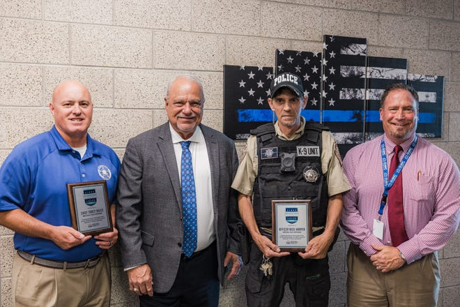 The Grand Lake Mental Health Center recognized local law enforcement Wednesday for their work connecting the community with mental health resources. Bartlesville Police Chief Tracy Roles, left, stands with GLMHC Chief Executive Officer Larry Smith, Barnsdall Police Officer Rick Harper and GLMHC Law Enforcement Engagement Director Jim Warring.