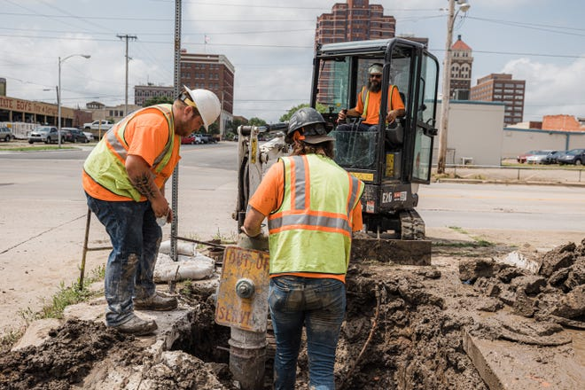 A city crew replaces a fire hydrant on Hensley Boulevard earlier this month. City workers are testing fire hydrants across Bartlesville.