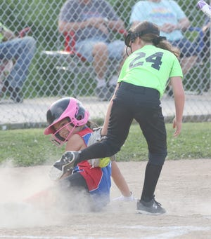 A Show Me State Home Inspections player was safe after the tag by Fayette pitcher Julia Young Tuesday night in Babe Ruth 10U softball at Lions park.