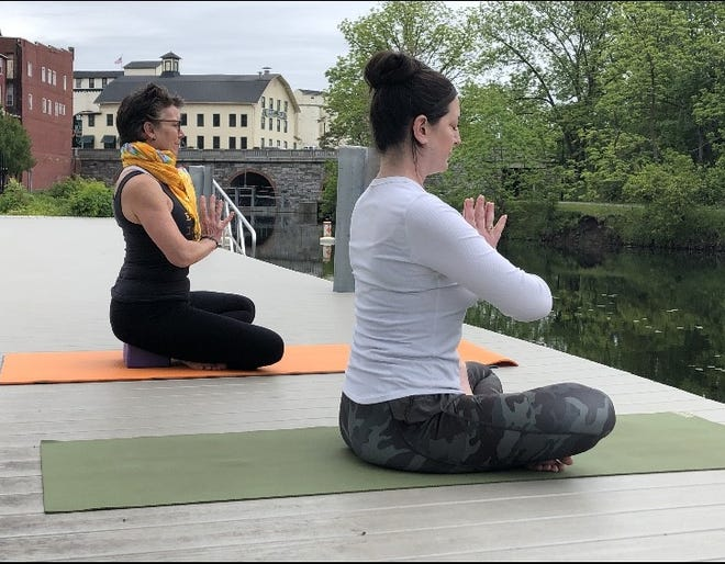 Jan Corning and Catherine Graves are offering Yoga classes at 10 a.m. every Saturday to benefit the Outlet Trail.