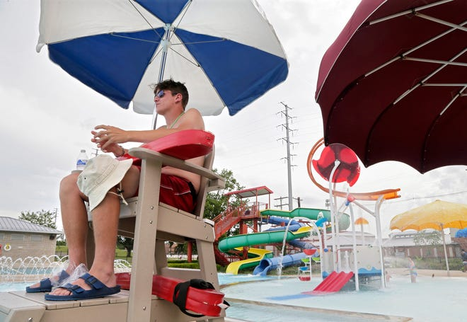 John Hooker, 18, of Whitehall, works as a lifeguard at the Dodge Recreation Center Pool on Tuesday.