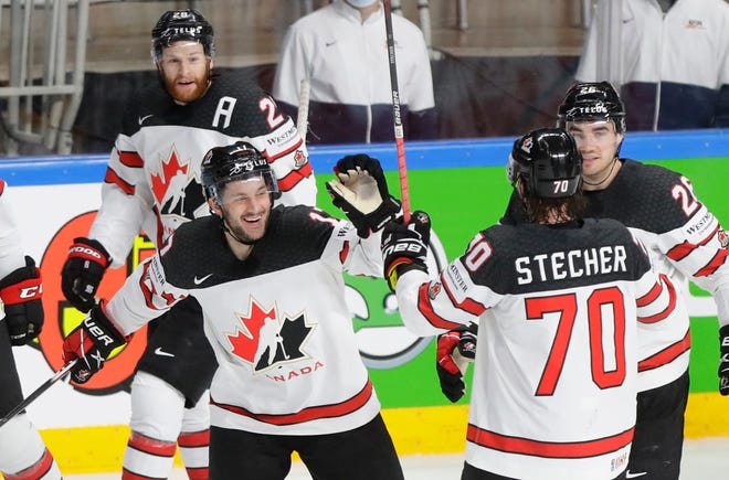 Justin Danforth, getting high-fives from teammates, played center for Canada in the world championship and finished with one empty-net goal.