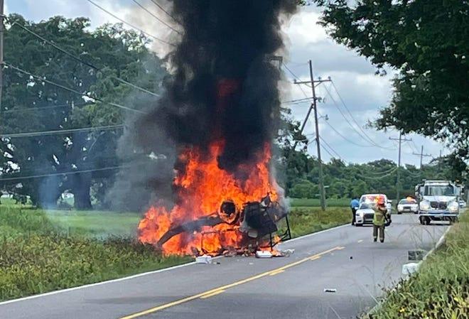 Fire crews battle a car fire Tuesday near Thibodaux.