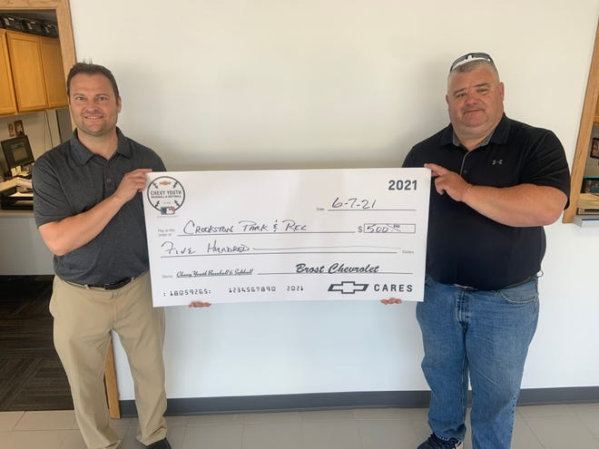 Eric Brost, left, is shown presenting the ceremonial large check to Parks & Recreation Supervisor Scott Butt.