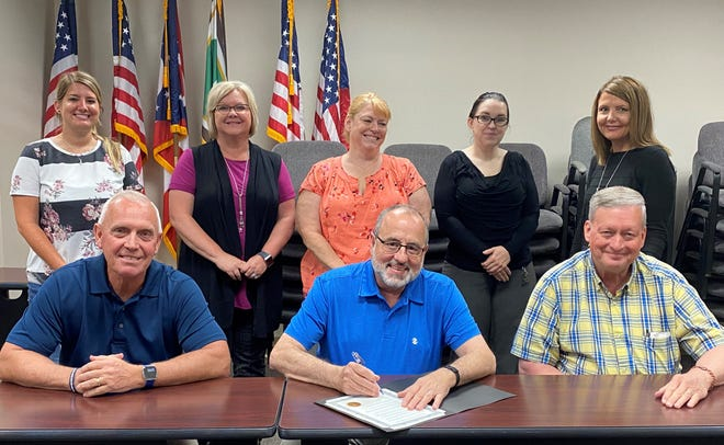 Guernsey County Commissioners, l to r, front row, signed a proclamation Wednesday in support of Elder Abuse Awareness Month. Also attending the signing were, back row, Lindsey Sullivan, Director Kathy Jamiel and Deana Haney of the Guernsey County Department of Job and Family Services; Jennifer Zaayer of the Guernsey County Prosecuting Attorney's Office; and Sue Sikora of DJFS.