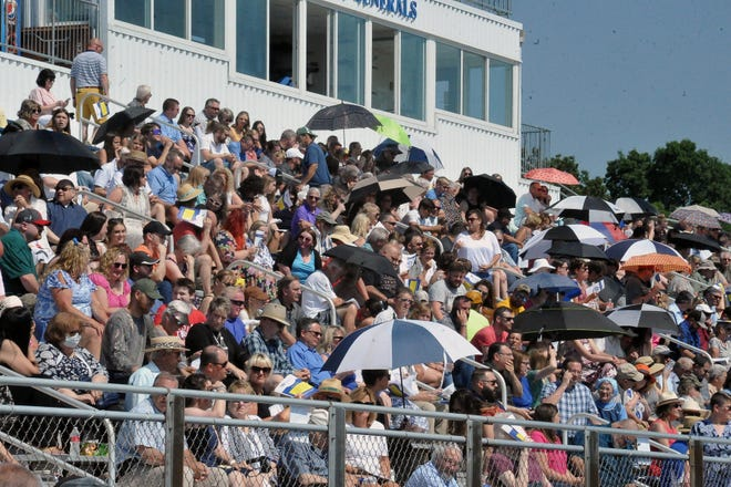 The stands of the Wooster High School football stadium were filled for the 2021 graduation ceremony. Since the ceremony was after the removal of the statewide mask mandate, masks were not worn by many people.