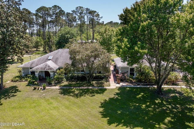 This incredible three-bedroom, two-bath, oversized two-car-garage home is nestled on five private acres in desirable Ormond Beach.