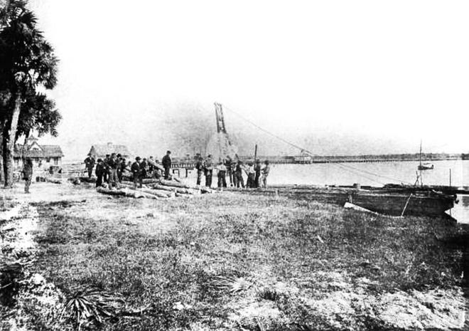 A work crew put up the first pilings for the Halifax River Yacht Club in 1896.