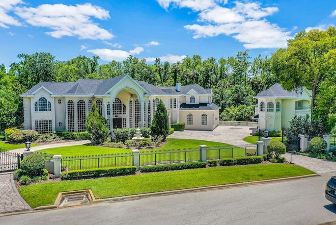 With the Tomoka River as its backdrop, this palatial gated mansion is a dream maker on nearly two-and-a-half acres in Ormond Beach's prestigious Broadwater subdivision.