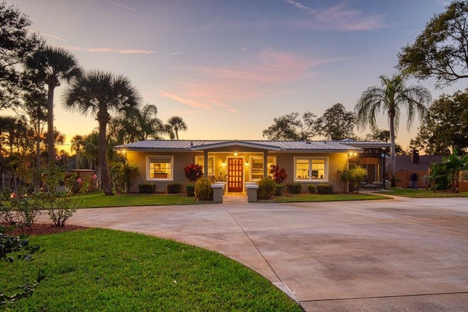 Sitting in the heart of The Trails, this boater's paradise is nestled on 5.25 acres along the Tomoka River in Ormond Beach.