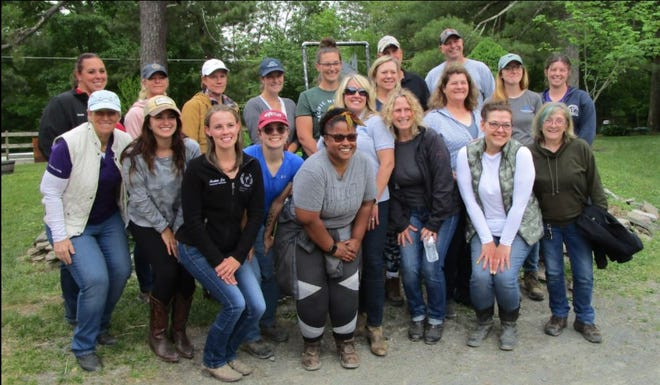 Equine Specialist Workshop participants are seen at GAIT Therapeutic Riding Center, Milford.