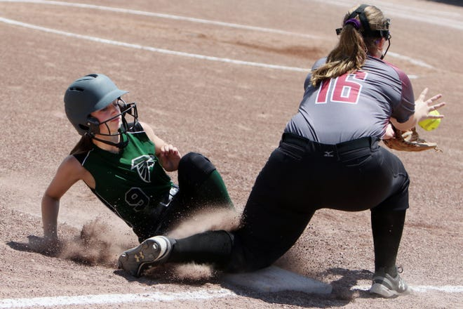 West Burlington-Notre Dame's Rowan Willeford (9) safely slides into third before Sarah Miller (16) can make the catch during their game against Hillcrest Academy Wednesday June 9, 2021 at West Burlington's Barb Carter Field.