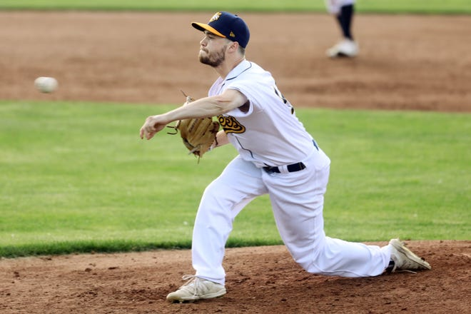 Burlington Bees Jackson Gray (14) delivers a pitch during their game against the Alton River Dragons Tuesday June 8, 2021, at Community Field.