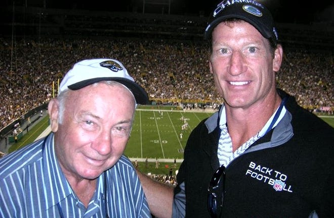Former Jaguars defensive lineman Don Davey (right) and his father, Kenneth, watch a 2011 NFL game at Green Bay's Lambeau Field. [Provided to the Times-Union]