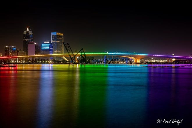 The rainbow lighting on the Acosta Bridge on Monday as it shone on the St. Johns River below to honor Pride Month.